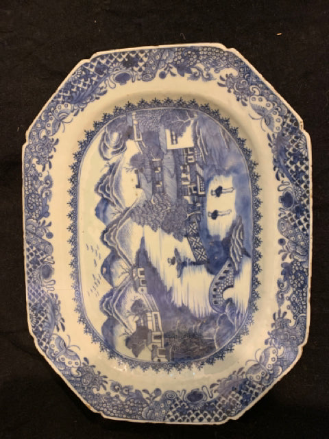 "Chinese Export Porcelain Platter.  This is an authentic late 18th Century Porcelain platter, made in China.  It has rim chips, a hairline crack, and old professional restoration to edge.  It is 13"" wide."