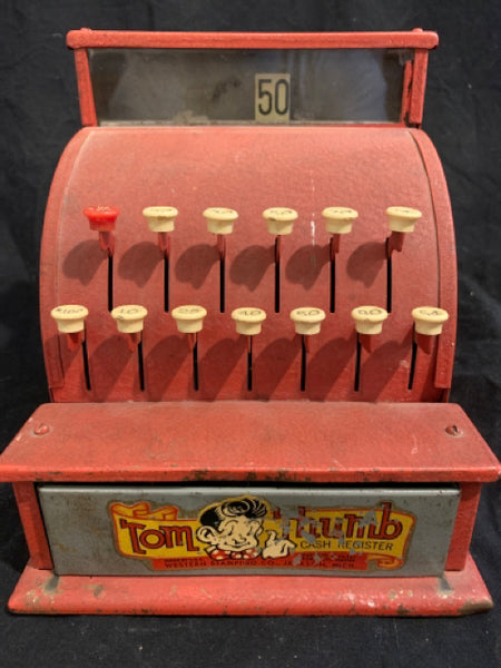 "Tom Thumb Toy Cash Register.  This is an authentic circa 1950s toy cash register.  It is in good condition, the metal has some very minor scrapes and wear, and is 7.5"" tall and 6.5"" wide."