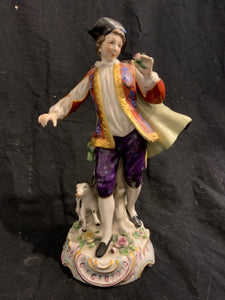 "Rococo Style Porcelain Figure - ""Man with Dog"".  This is an authentic Rococo style porcelain figure, made in Germany circa 1900.  It is in good condition, has no chips or repairs, and is 9.5"" tall."