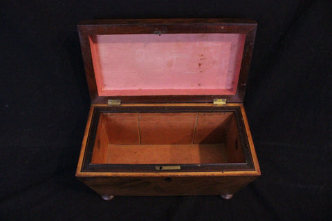 English Regency Mahogany tea caddy, circa 1820, in good condition.  Sarcophagus form with disc feet.