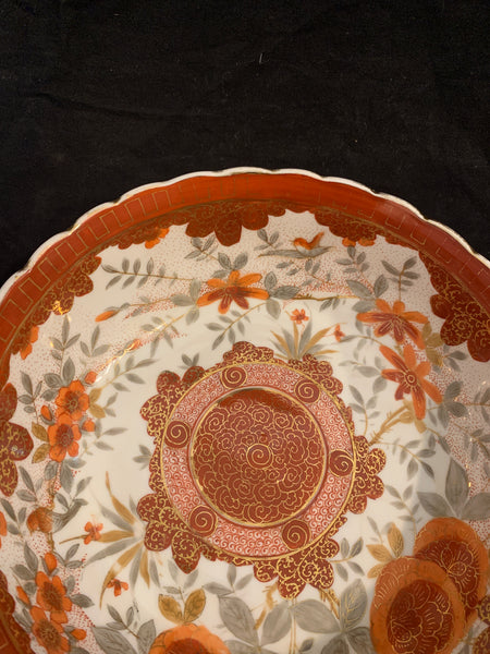 Vienna Porcelain Bowl, circa 1890.  The sides have a fluted form and arched rim.  It is decorated overall with brick red motif