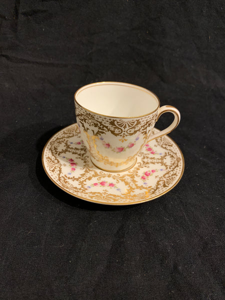 Royal Doulton Demi Tasse classical English cup and plate, with floral swags and gilt details