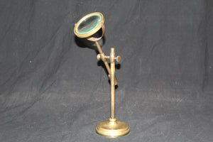 20th century brass magnifier with adjustable height and angle
