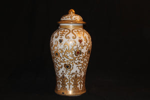 20th century reproduction urn. It is a bulbous form with a domed lid