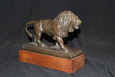 20th century classical plaster lion with bronze finish on a wood plith salva studios