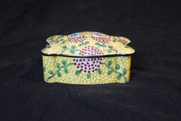 limoges asian porcelain box is made in France and has a domed cover