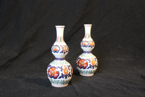 Pair of Imari style Japanese Double Gourd form Vases These reproduction vases are 20th century Japanese porcelain