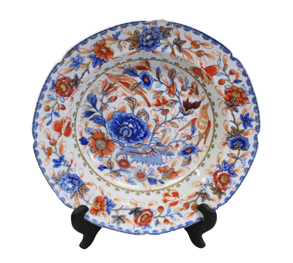 early 19th Century Decorative ironstone porcelain china bowl with floral and bird scenes in blue, orange and gold accents.
