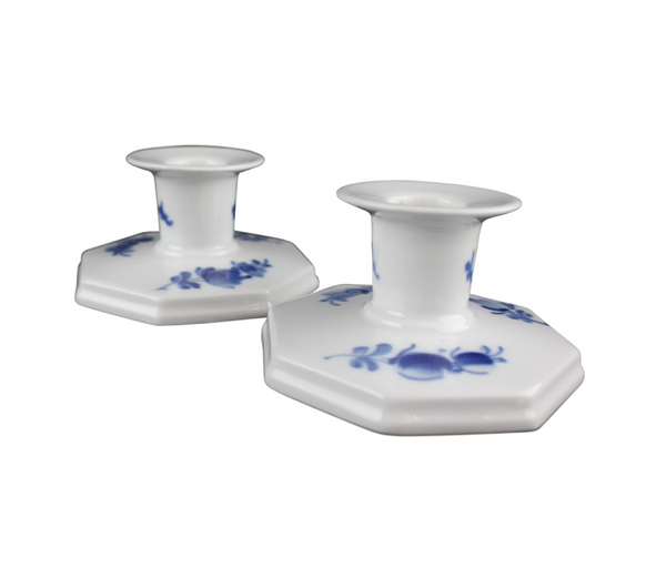 Pair of Royal Copenhagen ceramic ivory white porcelain candle holders with delicate painted blue floral design. The English Traditional pieces are from the Mid 20th Century