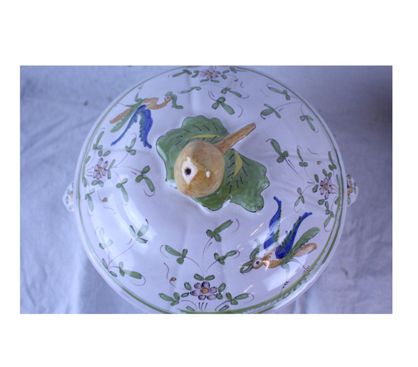 Century French pottery tureen with white background and green details of birds and flowers. Made in the mid 20th century