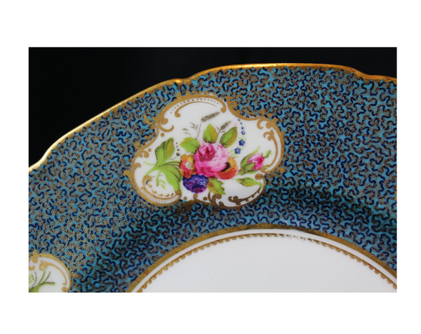 Twelve Royal Doulton antique traditional porcelain plates, beautiful blue borders with gilt details and floral centers. Made in England, early 20th century.