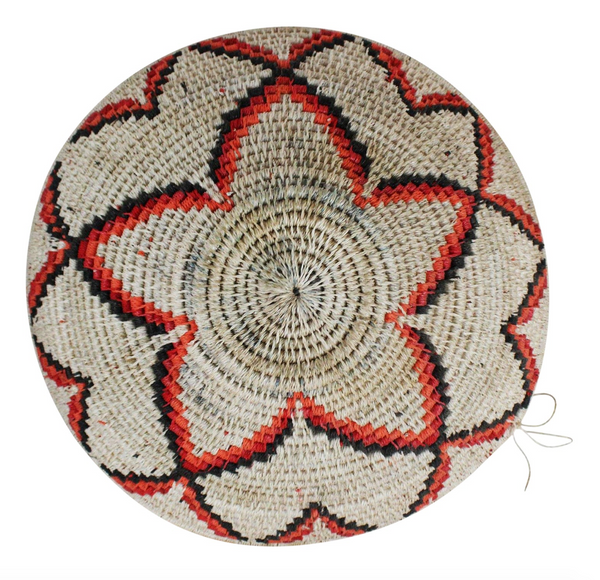 Handwoven grass African tribal basket with floral pattern in hues of brown, tan, and orange.  Made in Ghana during the mid 20th century