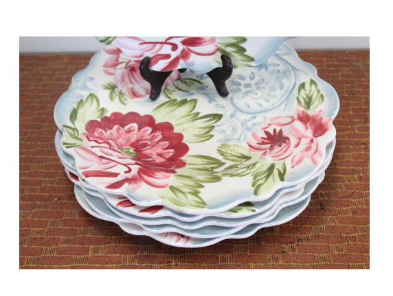 early 20th Century plates.  Six blue, white, green, and red floral cottage style ceramic plates with floral shaped rim.