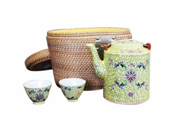 Unique mid 20th century hand made wicker basket with yellow upholstery and a Chinese yellow porcelain tea set for two