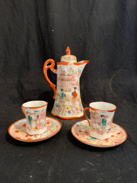 "Japanese Chocolate Pot with Pair of Cups & Saucers.  This is an authentic set of Asian Porcelain Chocolate Pot with Cups & Saucers, made in Japan circa 1910.  It is all in good condition, and the pot is 9.5"" tall."