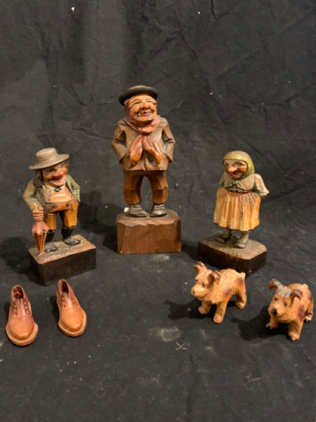"Collection of Anri Wood Carving Italian Folk Art.  These are mid 20th Century Italian peasant style wood folk art carvings.  They are in good condition, have stamp marks, and the tallest piece is 7""."