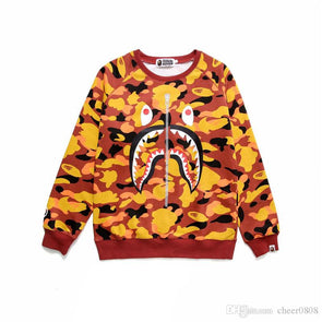 A Bathing Ape shark Camo crewneck orange