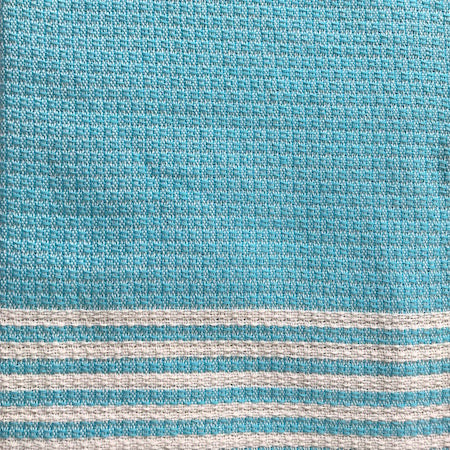 Azure authentic Turkish Towel features a pale turquoise and cream traditional weave across the main body of the towel, with alternating thin turquoise and cream stripes at each end