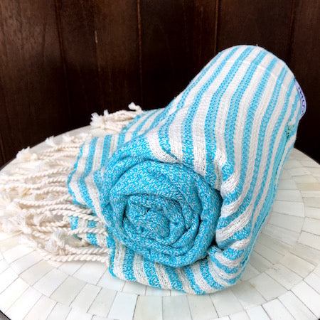 Lightweight and fast-drying, our authentic turkish towels roll up small, so they're perfect for a day at the beach