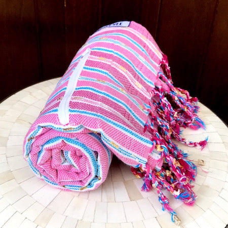 Our striped Berry turkish towel rolls up so small it is perfect for a day at the beach