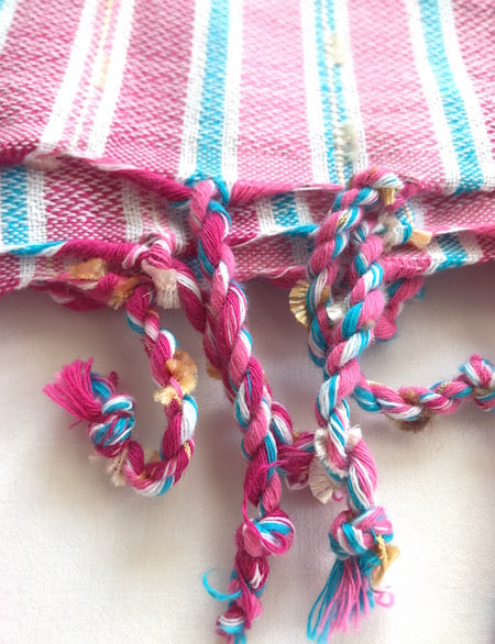 Our Berry Turkish Towel has beautiful hand-rolled tassels
