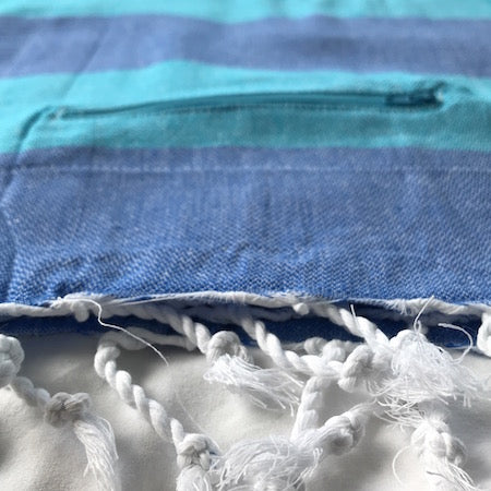 Big Blue Turkish Towel has a handy pocket to stash your stuff while you're in the water