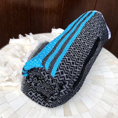 Black Sea Turkish Towel rolls up so small, its a perfect beach towel