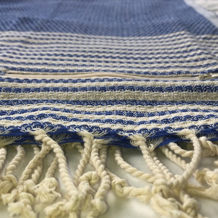 Deep Sea turkish towel has a discreet pocket, so it's perfect as a beach towel