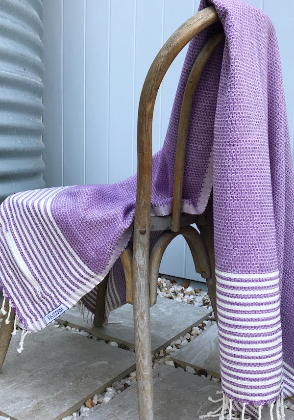 Freostyle Anemone Purple Turkish Towel with pocket, displayed