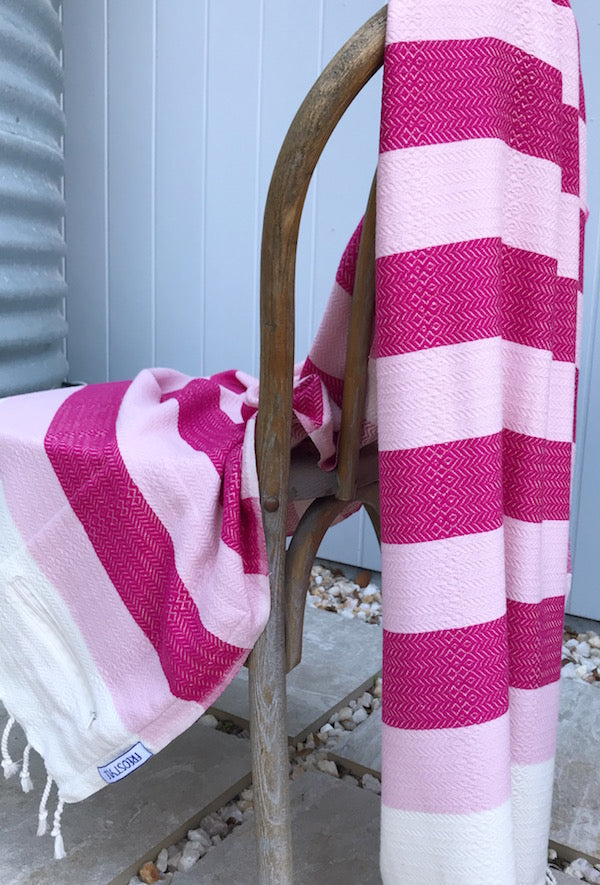 Freostyle Coral pink on pink & cream striped Turkish Towel with pocket, displayed