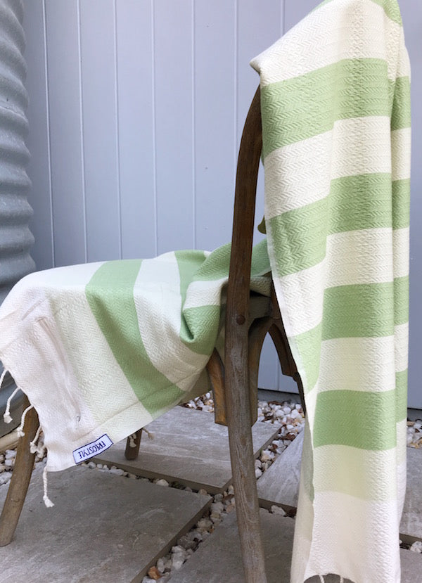 Freostyle Mandalay green & cream striped Turkish Towel with pocket, displayed