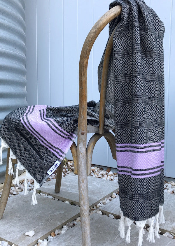 Freostyle Purple Skies black and purple striped Turkish Towel with pocket, displayed