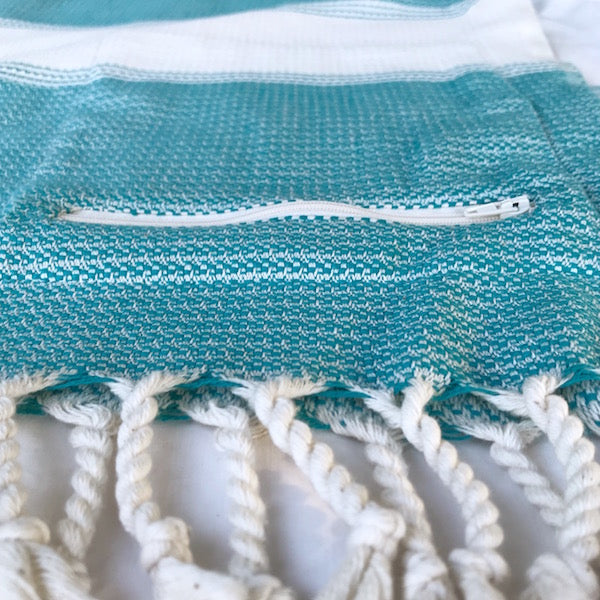 FREOSTYLE SEAGRASS TURKISH TOWEL HAS A HANDY ZIP UP POCKET TO STASH YOUR STUFF WHILE YOU SWIM
