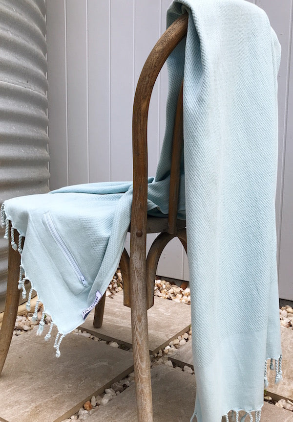 Freostyle Zamami power blue Turkish Towel with pockets, displayed