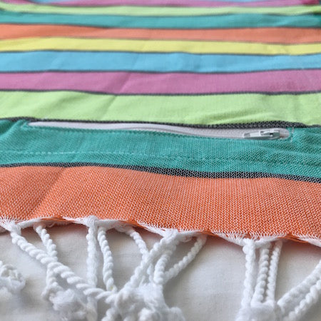 Happy: ethically made authentic Turkish Towel with pocket in a cheerful bold multi-colour stripe