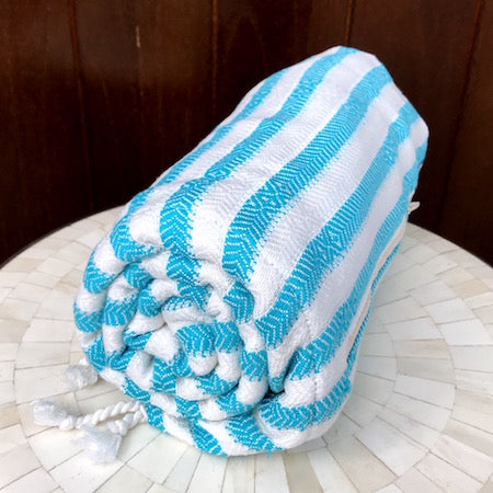 Lagoon Turkish Towels roll up slim and small