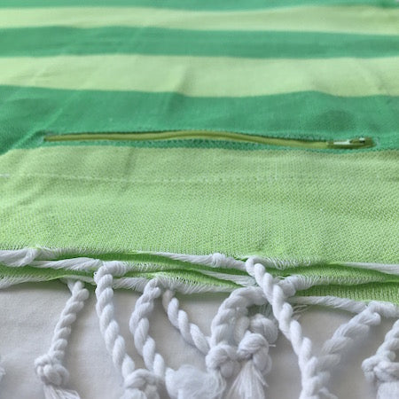 Limes Turkish Towel with pocket in a bold green on green stripe