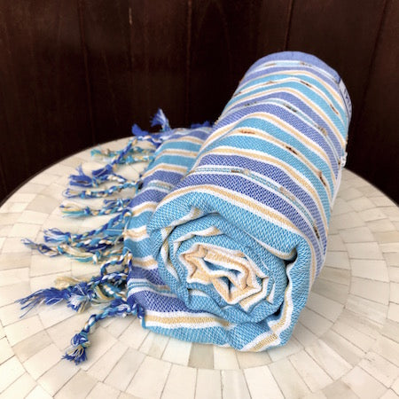 Lightweight & fast-drying, our genuine Turkish Towels roll up so small
