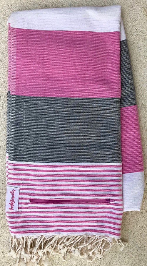 Pondicherry Pocketowel rocks Pink, Grey and White stripes for a retro coastal vibe. Pocketowels are large beach towels with pockets
