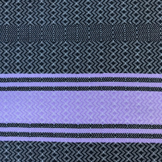 Purple Skies is an ethically made turkish towel with pockets, in black with a purple feature stripe