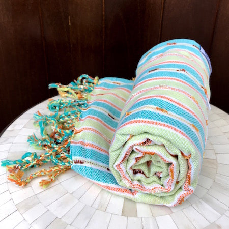 The light-weight Rockpool turkish towel rolls up small