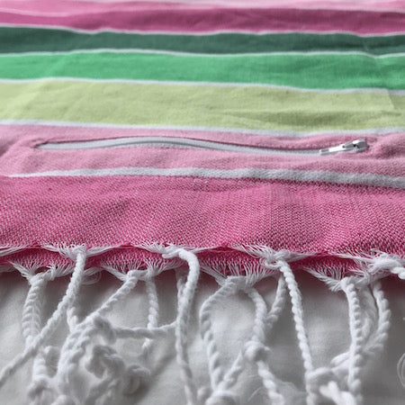 Spring turkish towel has a pocket so it's perfect for a beach towel - with a discreet place to stash your stuff!