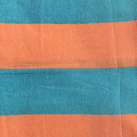 Our SunSea authentic Turkish Towel alternates bold blue and orange horizontal stripes, and is finished with white tassel