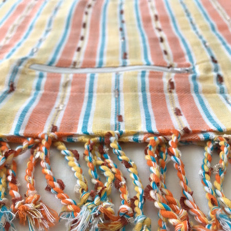 Sunset Stripe: stunning turkish towel with handy pocket, in orange, yellow and blue woven stripes