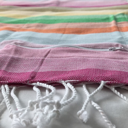 Ethically made Wildflowers turkish towel features hand-rolled tassels and a nifty hidden pocket