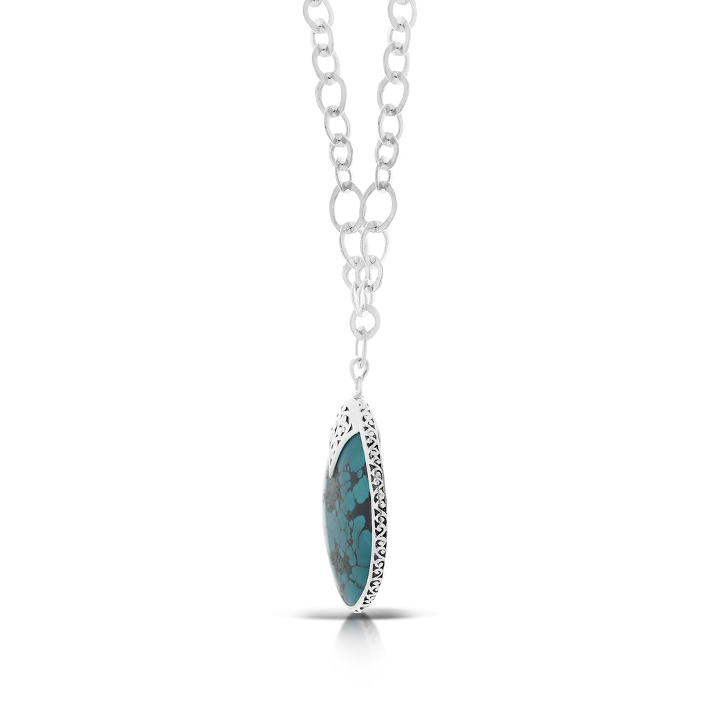"Organic Shaped Turquoise with Hand Carved LH Scroll Rim on Handmade Sterling 19"" Silver Chain.  Pendant 40mm by 47mm"
