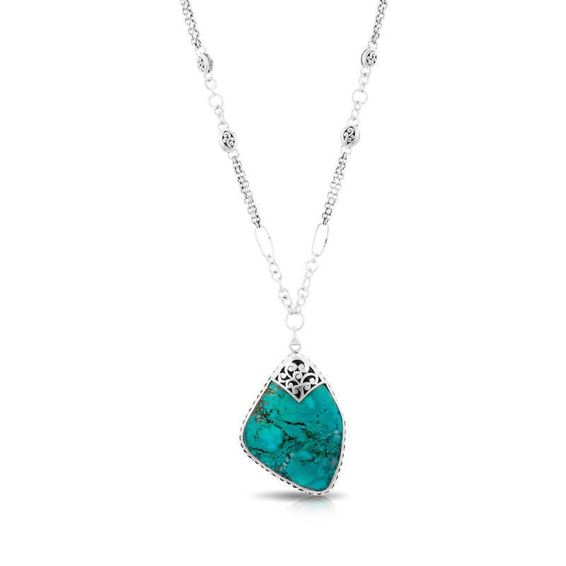 "Organic Shaped Turquoise with Hand Carved LH Scroll Rim on Handmade Sterling 17"" Silver Chain. Pendant 37 by 50 mm"