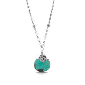 "Organic Shaped Turquoise with Hand Carved LH Scroll Rim on Handmade Sterling 17"" Silver Chain. Pendant 40 by 43 mm"