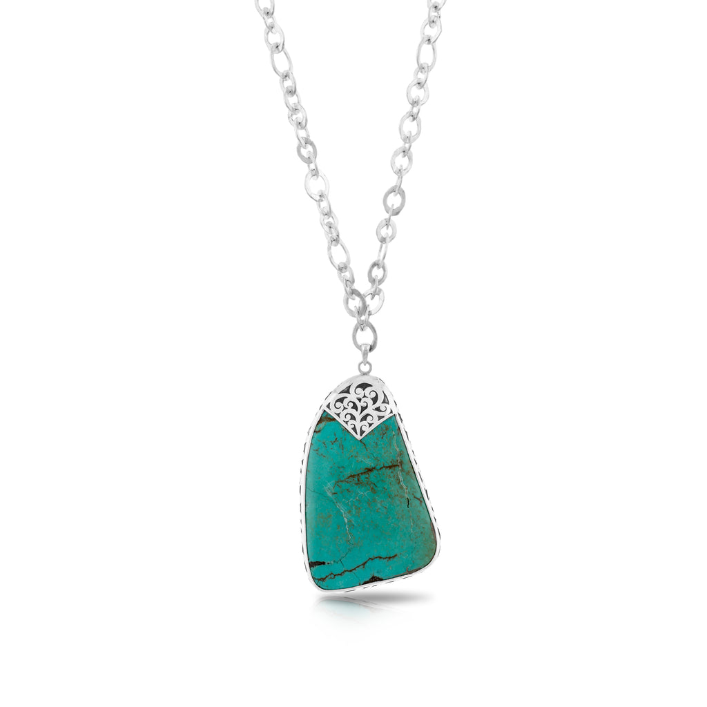 "Organic Shaped Turquoise with Hand Carved LH Scroll Rim on Handmade Sterling 19"" Silver Chain. Pendant 42 by 66 mm"
