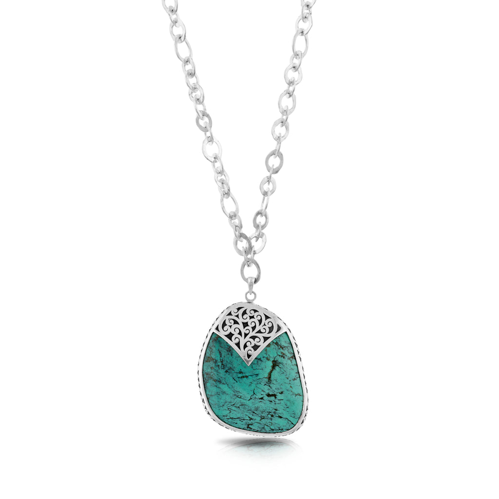 "Organic Shaped Turquoise with Hand Carved LH Scroll Rim on Handmade Sterling 17"" Silver Chain. Pendant 41 by 52 mm"